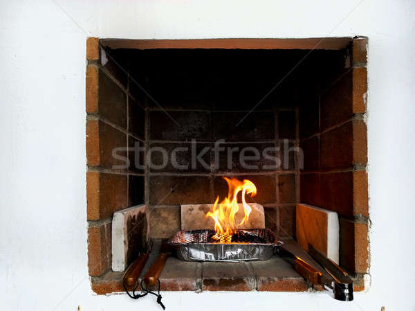 Single use barbecue with flaming coals Stock photo © amok