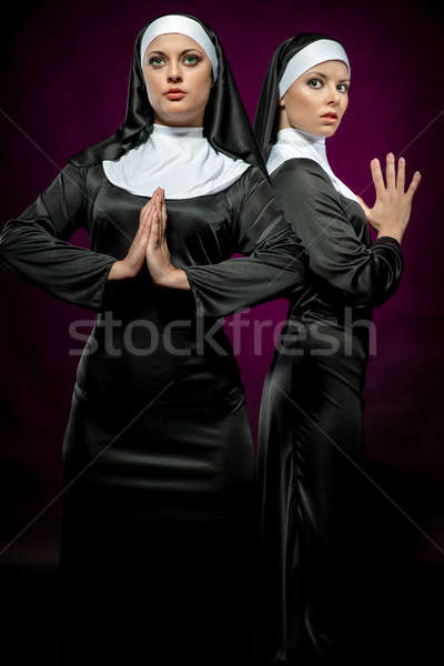 Two attractive young nuns posing indoors Stock photo © amok