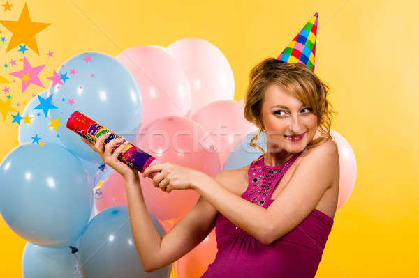 Beautiful young woman with firecracker indoors Stock photo © amok