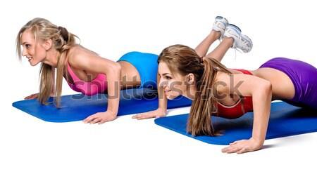 Young women doing push-up exercise  Stock photo © amok