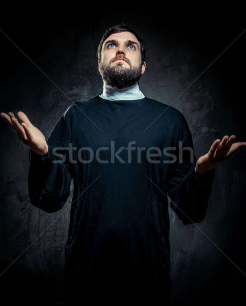 Portrait of priest against dark background Stock photo © amok