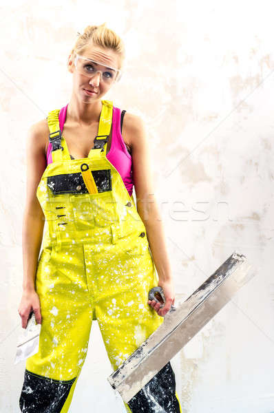 Tired female construction worker with putty knife working indoor Stock photo © amok