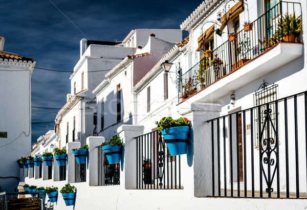 Typical spanish white village houses with flower pots.  Stock photo © amok