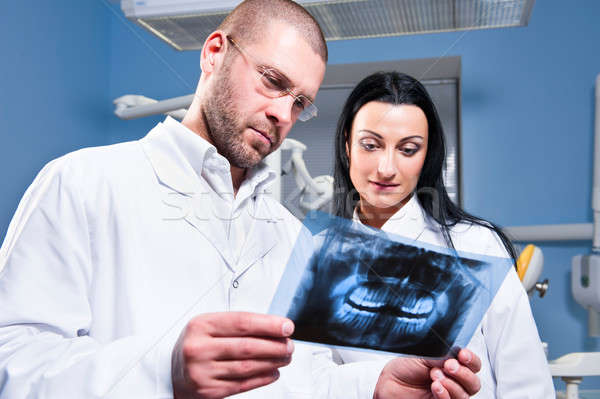 Dentist and assistant checking x-ray at dental clinic Stock photo © amok