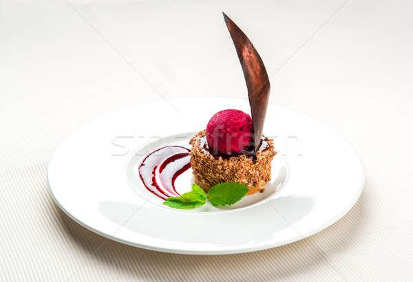 Delicious caramel cake with blackcurrant sauce Stock photo © amok