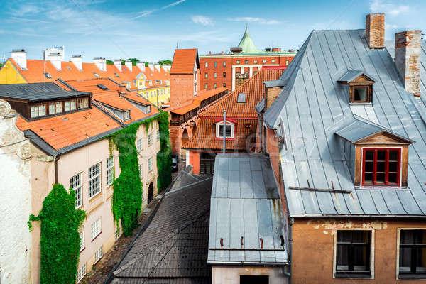 Riga óváros tetők Lettország égbolt épület Stock fotó © amok
