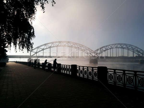 Fisherman's on the Daugava embankment and Railway bridge  Stock photo © amok
