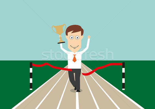 Businessman crossing finish line with trophy cup Stock photo © anbuch