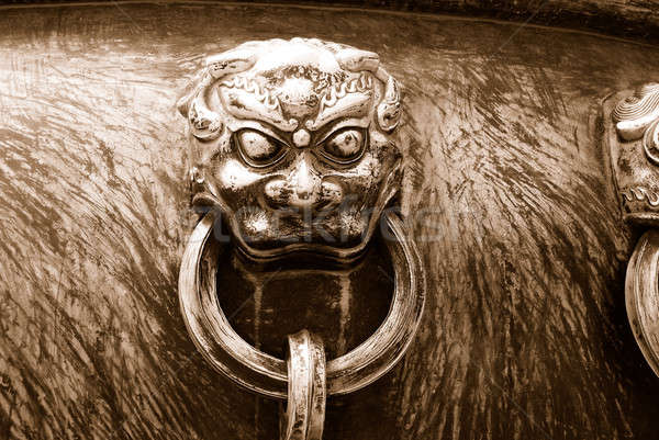Ancient bronze lions as a handle of vat - in sepia Stock photo © anbuch