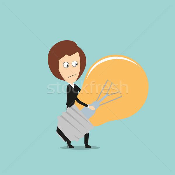 Business woman carrying huge idea light bulb Stock photo © anbuch