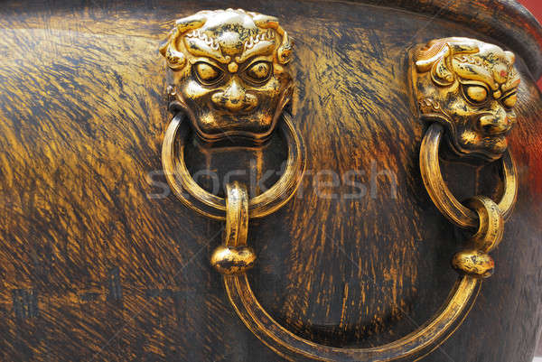 Ancient bronze lions as a handle of vat Stock photo © anbuch