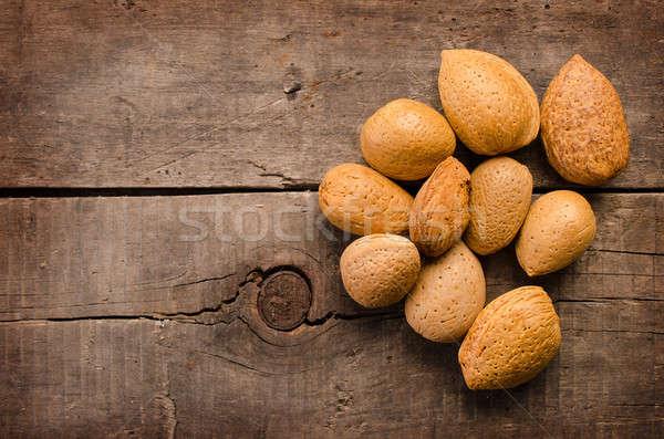 Almonds on wood Stock photo © andreasberheide