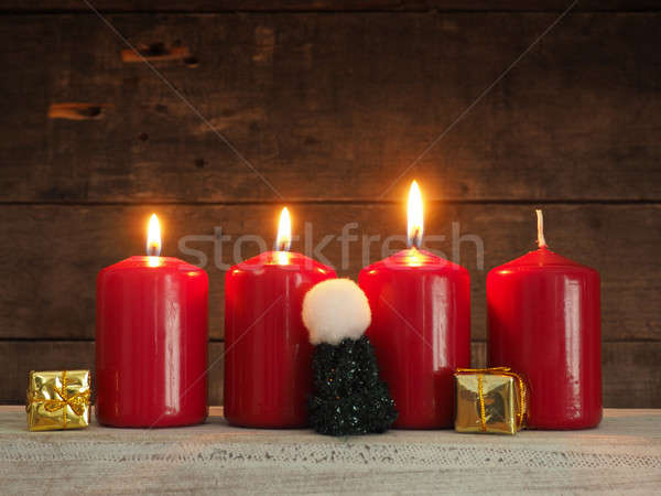 Four red Advent candles on wood Stock photo © andreasberheide