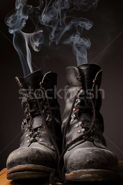 Old boots with smoke Stock photo © andreasberheide