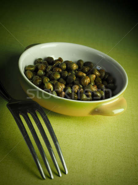 Capers in a rustic bowl Stock photo © andreasberheide
