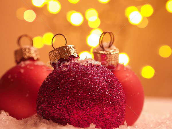 Three Christmas baubles in snow  Stock photo © andreasberheide