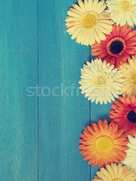 Színes virág dekoráció fa kék fából készült Stock fotó © andreasberheide
