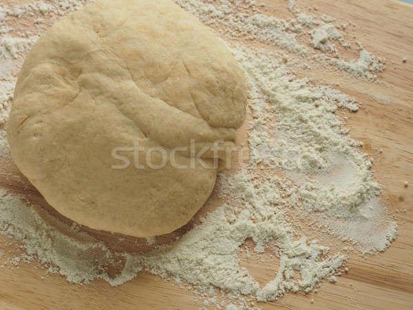 Pizza dough on wooden board Stock photo © andreasberheide