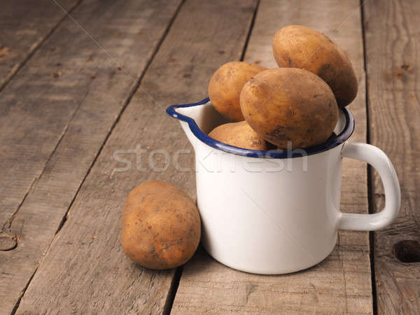Organic potatoes in a cup Stock photo © andreasberheide