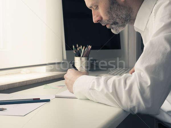 Férfi rajz papír lap kreativitás természetes fény Stock fotó © andreasberheide