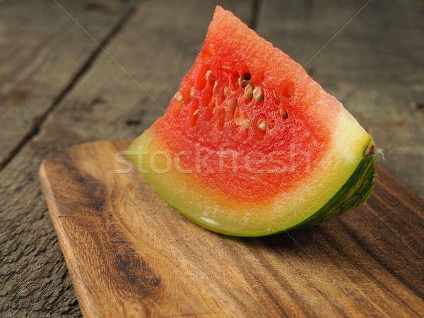 Water melon on rustic wood Stock photo © andreasberheide