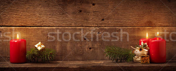 Three candles on rustic wood Stock photo © andreasberheide