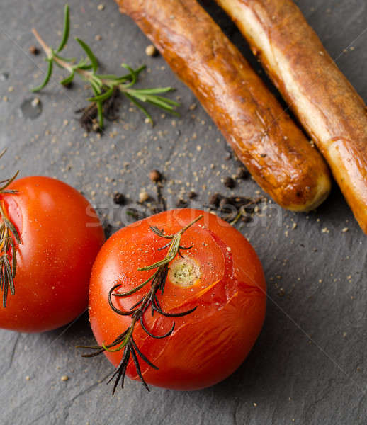 Grilled tomatoes with sausages Stock photo © andreasberheide