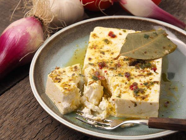 Organikus fetasajt gyógynövények olívaolaj rusztikus tányér Stock fotó © andreasberheide