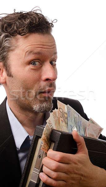 Pénzkeresés vicces üzletember bőrönd pénz férfi Stock fotó © andreasberheide