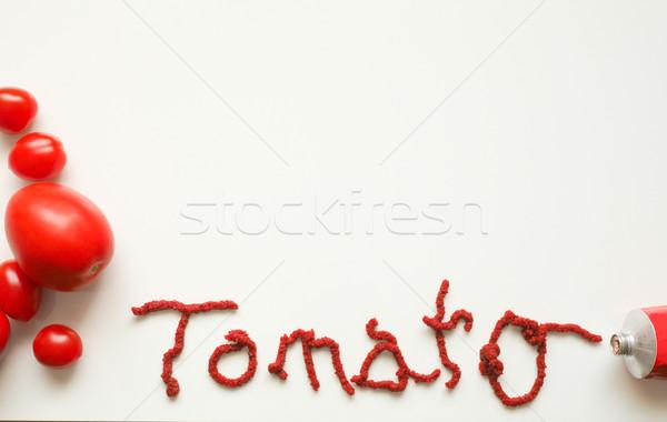 Fresh tomatoes with the word tomato Stock photo © andreasberheide