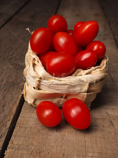 Organic grape tomatoes in a basket Stock photo © andreasberheide
