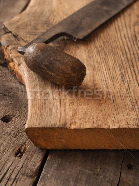 Old wood plane on oak plank Stock photo © andreasberheide