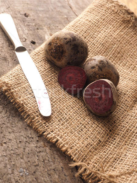 Organic beet root on rustic background Stock photo © andreasberheide