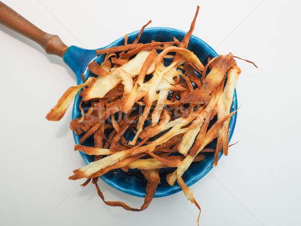 Homemade parsnip chips Stock photo © andreasberheide