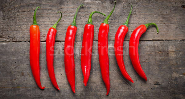 Red chilies on wood Stock photo © andreasberheide