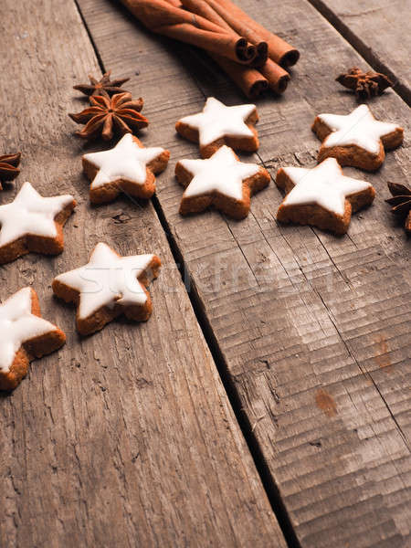 Sweet cinnamon stars on a wooden table Stock photo © andreasberheide