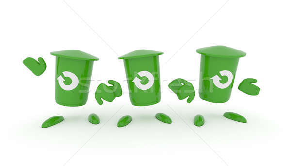 Stock photo: Recycling concept with green garbage bin