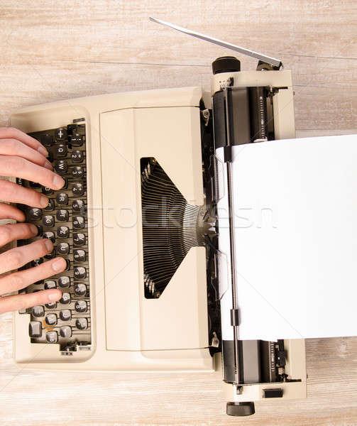 Male hand writing on a vintage typewriter Stock photo © andreasberheide