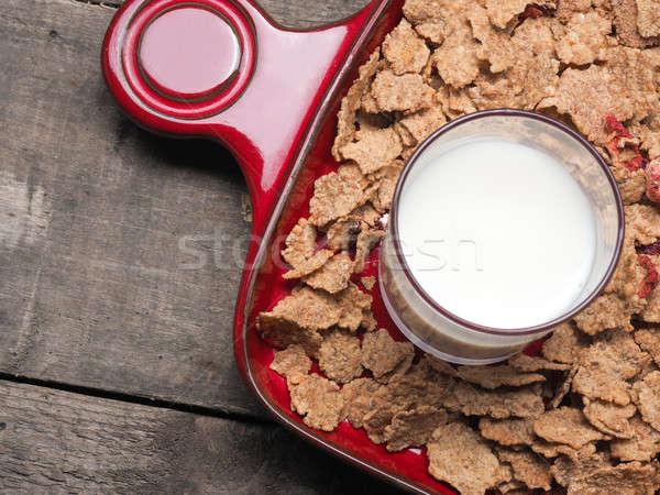 Tej müzli üveg piros tányér háttér Stock fotó © andreasberheide