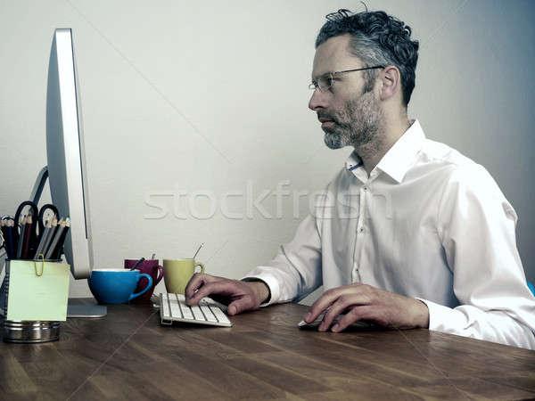 Tired businessman at night office Stock photo © andreasberheide