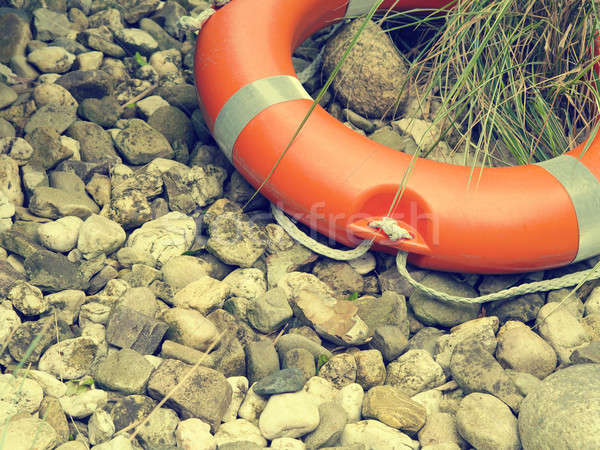 Rescue belt on pebbles Stock photo © andreasberheide