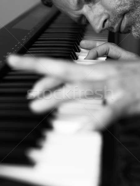 Ma playing piano Stock photo © andreasberheide