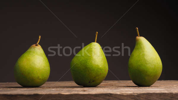 Three organic pears on wood Stock photo © andreasberheide