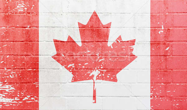 Stock photo: White brick wall with Canadian flag
