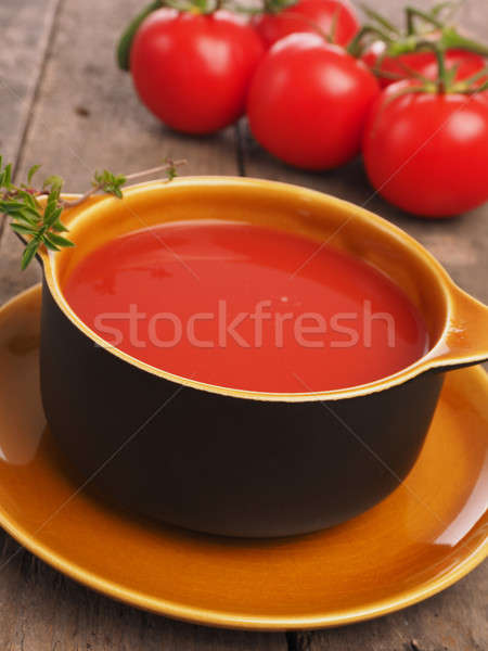 Gazpacho in a rustic bowl on a wooden table Stock photo © andreasberheide