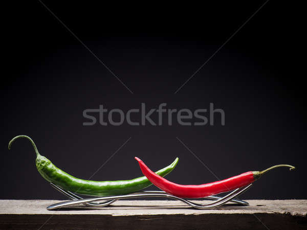 Two chilies on forks Stock photo © andreasberheide