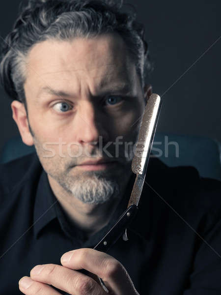 Man with shaving knife Stock photo © andreasberheide