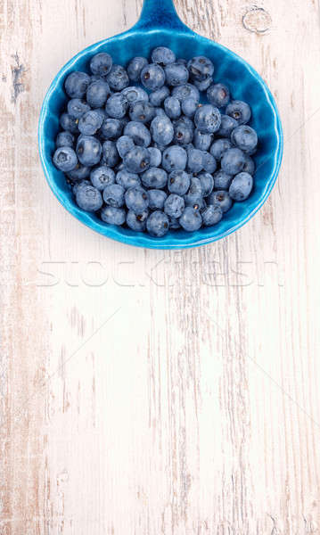 Fresh blueberries in a rustic bowl Stock photo © andreasberheide