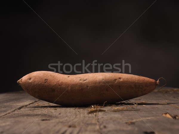 Fresh batata on wood Stock photo © andreasberheide