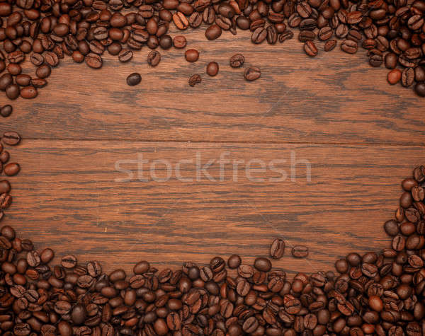 Espresso beans on an oak texture Stock photo © andreasberheide